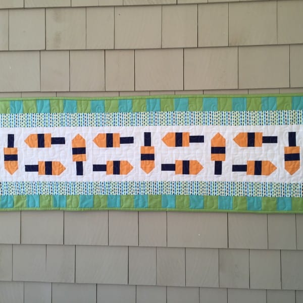 Little buoys table runner on wall